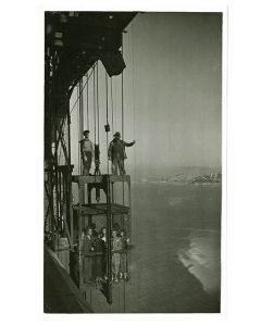 Building elevator with workers and guests, opening celebration, 1937 May